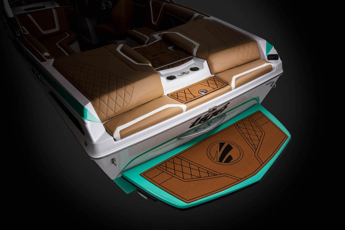 the Tige Boat 21ZX Backstorage surfboard locker let you have hide space and stoc