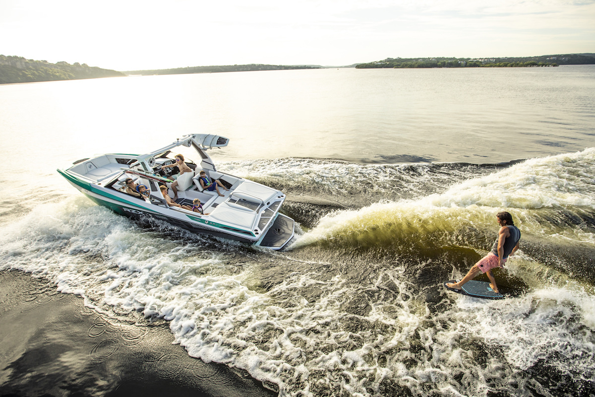 Tige 22RZX pulling a wakesurfer. The wake is completely adjustable and can be controlled from a remote