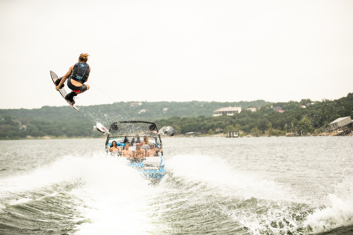 Wakesurfing behind a Tige 23ZX. The wake is completely adjustable and can be controlled from a remote