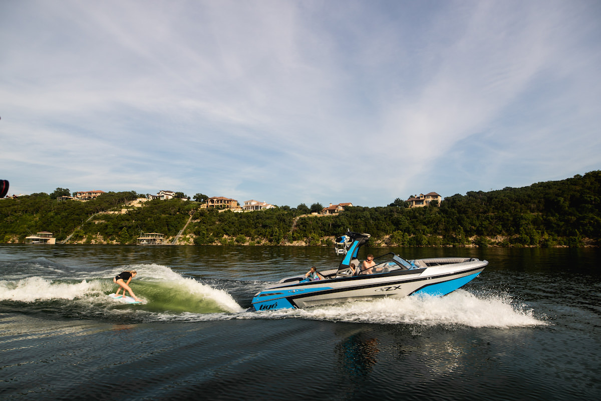 Tige 23ZX pulling a wakesurfer. The wake is completely adjustable and can be controlled from a remote
