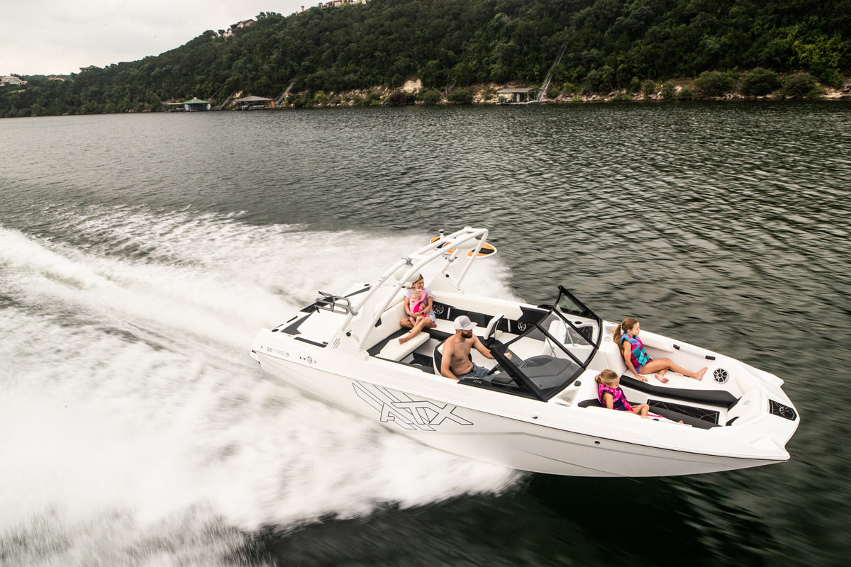 Tige Boat ATX22 Type-S Ghost Edition running with a family, the boat is romy and perfect for a day on the bay with family or a group of friends