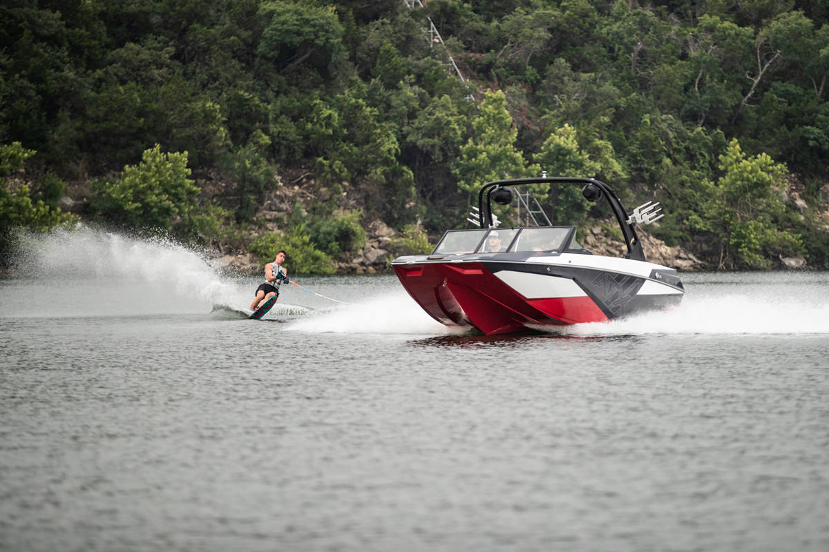 Tige ATX22 type-s pulling a wakesurfer. The wake is completely adjustable and can be controlled from a remote