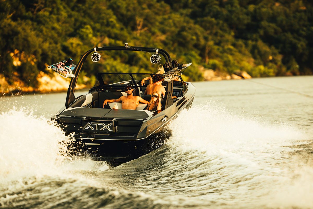 Tige Boat ATX22 Type-S Phantom Edition running with a family, the boat is romy and perfect for a day on the bay with family or a group of friends