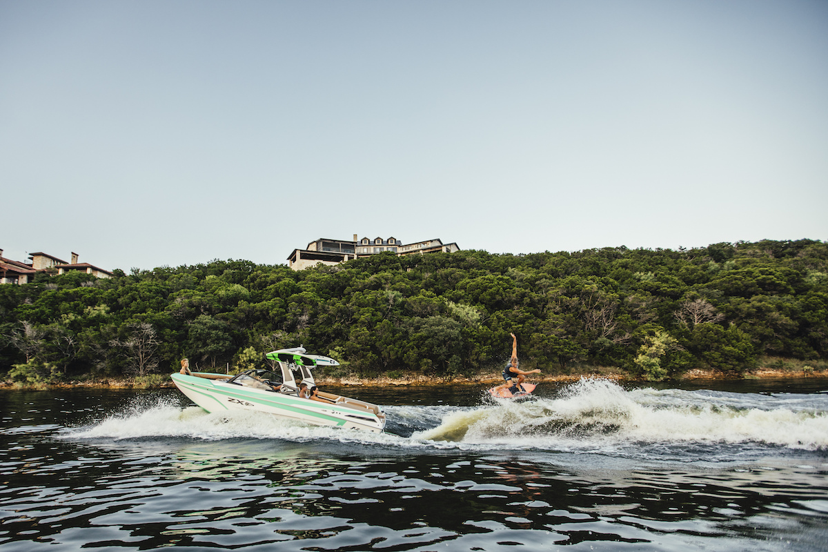 Tige Boat ZX21 pulling a wakesurfer. The wake is completely adjustable and can be controlled from a remote