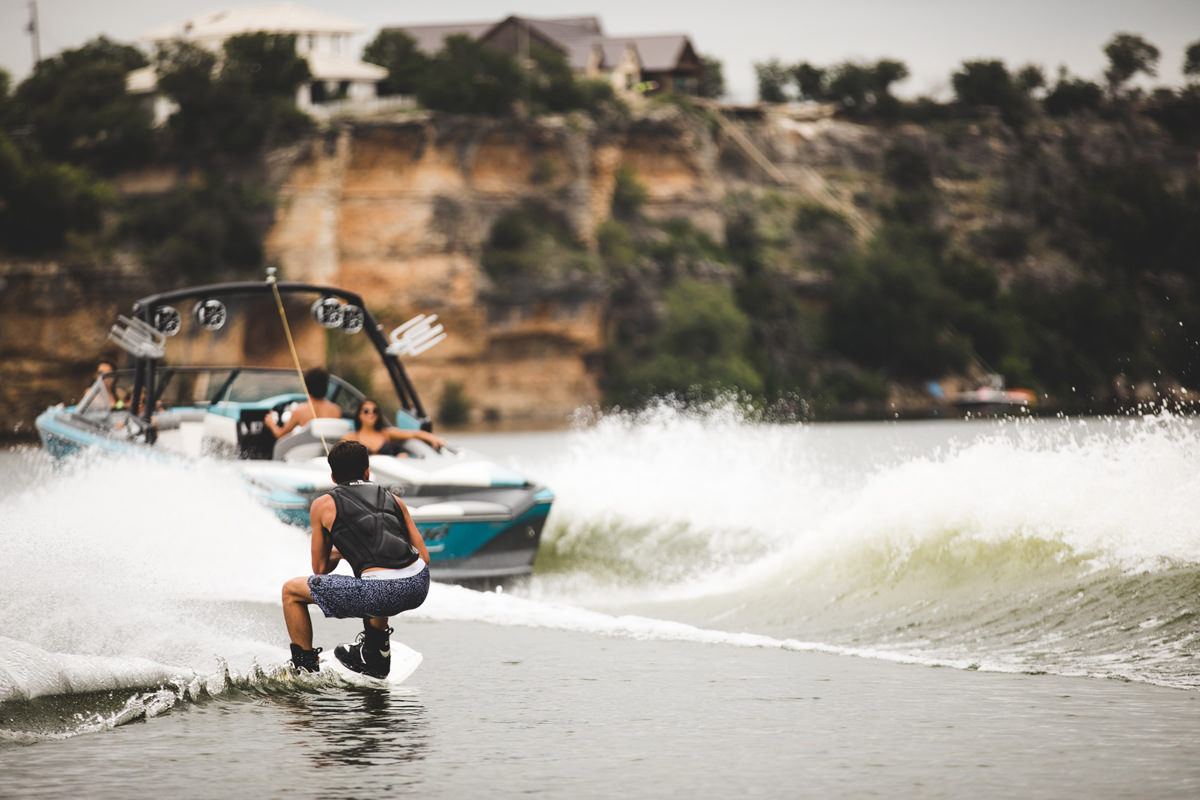 Tige Boat R23 pulling a Wakeboarder