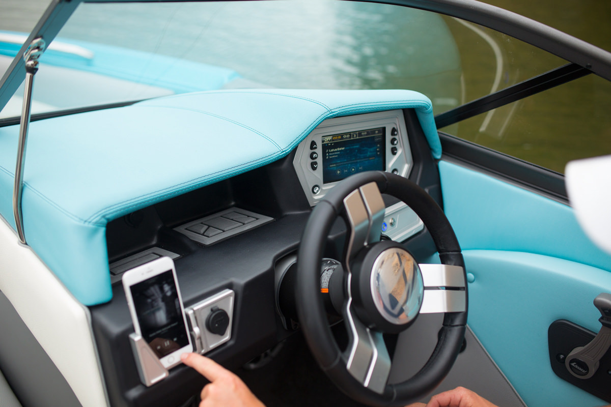 The Tige Boat R23 is equipped with a wireless phone charger and holder